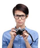 Beautiful woman hands retro photographic camera — Stock Photo