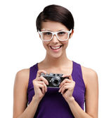 Woman holds retro photographic camera — Stock Photo