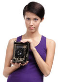 Woman with rarity photographic camera — Stock Photo