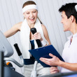 Athletic woman training on gym training in gym with coach — Stock Photo