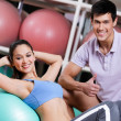 Athlete woman exercises in fitness gym — Stock Photo