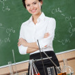 Stock Photo: Smiley chemistry teacher with crossed arms