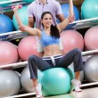 Sportive woman exercises in fitness gym — Stock Photo