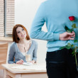 Man keeps red rose behind his back — Stock Photo