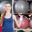 Royalty-Free Stock Photo: Athletic woman works out with gymnastic stick