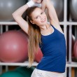Athlete woman stretching herself — Stock Photo #12748975