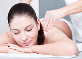 Woman receives massage therapy — Stock Photo