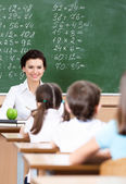 Teacher questions pupils — Stock Photo
