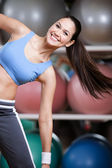 Athletic woman training with dumbbells — Stock Photo