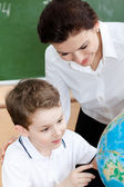 Studying geography with school teacher — Stock Photo