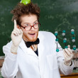 Mad scientist with an apple on his head shows forefinger while handing mole — Stock Photo #12806083