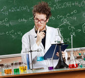 Mad professor considers the results — Stock Photo