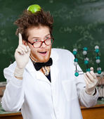 Mad scientist with an apple on his head shows forefinger while handing mole — Stock Photo