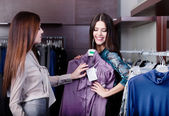 Friends try on an amazing dress — Stock Photo