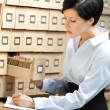 Woman looks for something in card catalog - Stock Photo