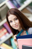 Female undergraduate with notebooks — Stock Photo