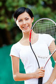 Portrait of young female tennis player — Stock Photo