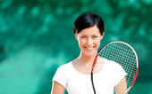 Portrait of smiling female tennis player — Stock Photo