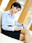 Business woman rests at the sofa — Stock Photo