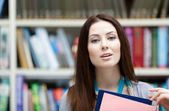 Female student with notebooks — Stockfoto