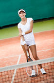 Sportive woman at the tennis court — Stok fotoğraf