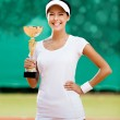 Successful female tennis player won the match — Stock Photo