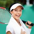 Stock Photo: Female tennis player with towel on her shoulders