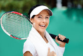 Female tennis player with towel on her shoulders — Stock Photo