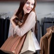 Hugging paper bags — Stock Photo