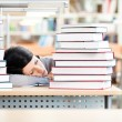 Pretty student sleeping at the desk - Stock Photo