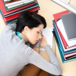 Female student sleeping at the desk - Stock Photo