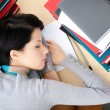 Student sleeping at the desk - Stock Photo