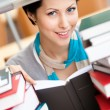 Reading book smiley female student — Stock Photo