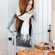 Stock Photo: Lady in scarf looking at bakery showcase