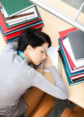Female student sleeping at the desk — Stock Photo