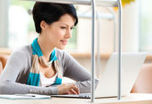 Woman browsing on the laptop — Stock Photo