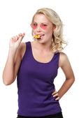 Flirting woman with lollypop — Stock Photo