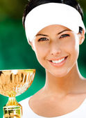 Female tennis player won the cup — Stock Photo