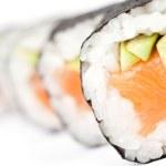 Row of prepared maki rolls — Stock Photo #13382100