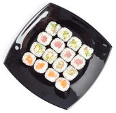 Black rectangle plate with sushi — Stock Photo