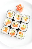 Square of sushi rolls with sashimi — Stock Photo