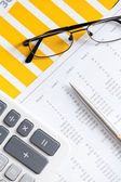 Close up of business documents and glasses — Stock Photo