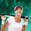 Sportswoman with racquet at the tennis court — Stock Photo