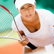 Stock Photo: Beautiful sportswomin sportswear playing tennis