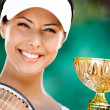 Successful tennis player won the cup — Stock Photo