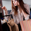 Speaking on the phone and buying clothes at the store - Foto de Stock
