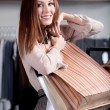 Carrying paper bags woman is happy — Stock Photo #13538503