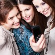 Girls snap themselves after shopping — Stock Photo #13538630