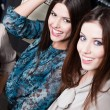 Happiness of two girlfriends with long dark hair — Stock Photo #13538632