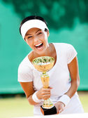 Young female tennis player won the tournament — Stock Photo